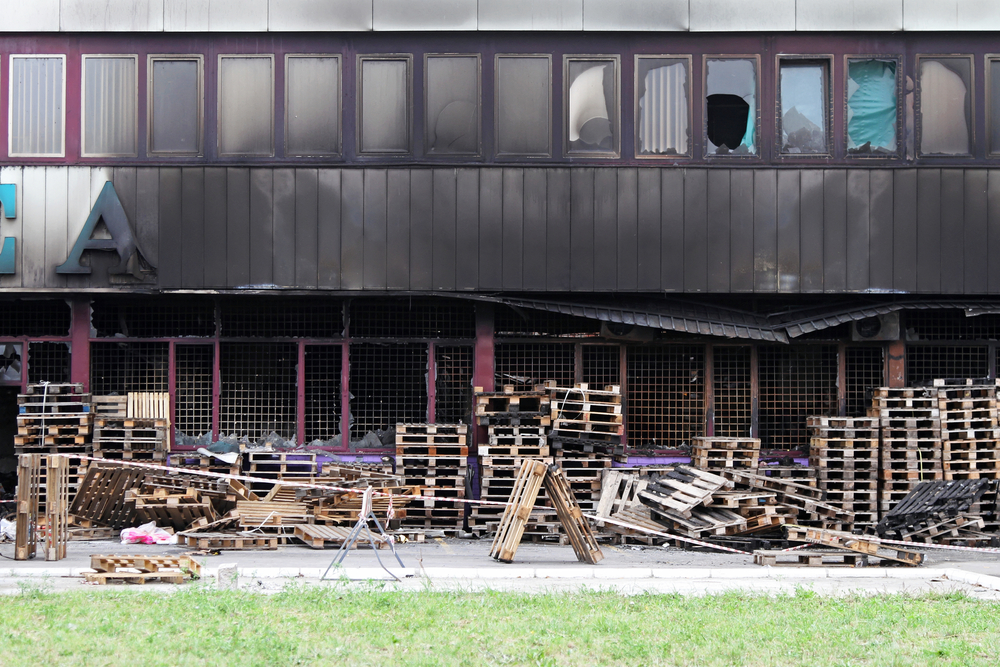 Empty pallet stacks that contributed to a fire.