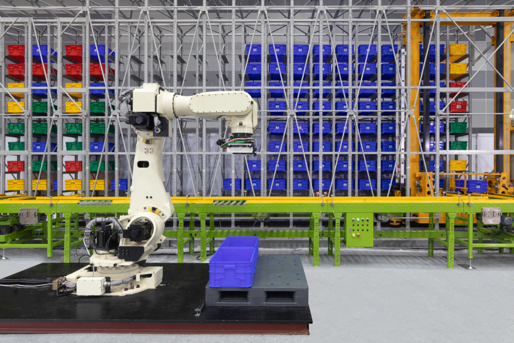 Palletizing being performed by a robotic arm.