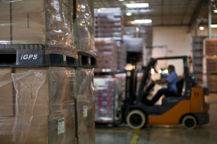 Forklift driver picking product in a warehouse