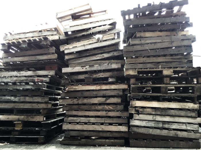 Damaged wood pallets show the state of the pallet market