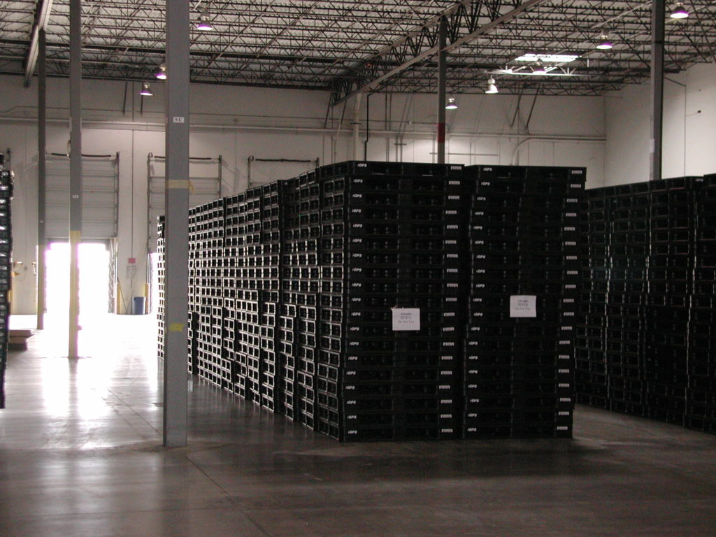 Idle pallet storage in a warehouse bay.