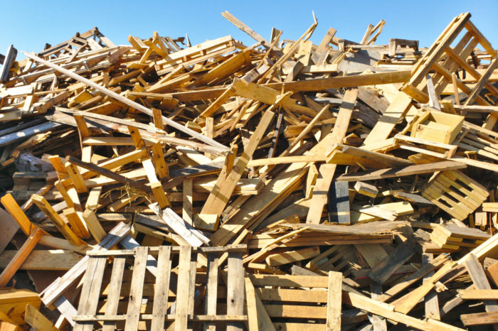 Used wood pallets in a landfill
