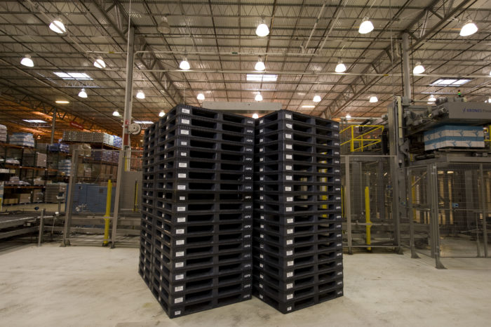 Pooled plastic pallets help optimize warehouse space.
