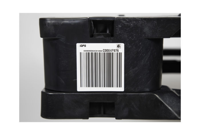 Plastic pallets have barcodes and embedded RFID tags for easy pharmaceutical tracking.