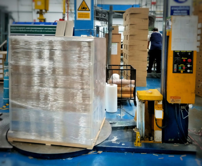 Pallet of products being plastic wrapped.