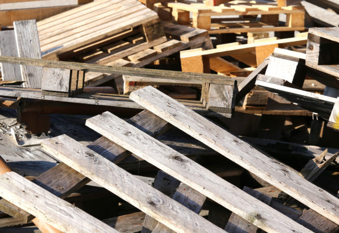 Used wood pallets in a landfill.