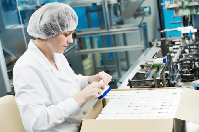 Packaging pharmaceuticals at a manufacturer